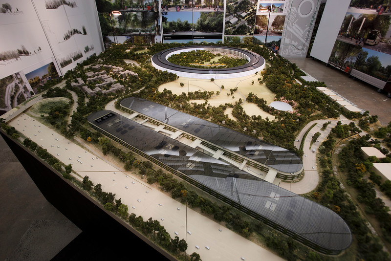An overview of a rendering of Apple's proposed new campus. The plan will go up for a final vote before the Cupertino City Council on Oct. 15. The rendering was photographed at an Apple's office located at the proposed new campus site on Oct. 10, 2013 in Cupertino. (Dai Sugano/Bay Area News Group)